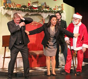 "Submitted photo MIRACLE: From left, Frank Poff, Candance Clemmons, Brendan Ferrell and Brett Muncrief rehearse for The Pocket Community Theatre's ""Miracle on 34th Street"" production. Showtimes are 7:30 p.m. Dec. 1-2, 2:30 p.m. Dec. 3, 7:30 p.m. Dec. 8-9, and 2:30 p.m. Dec. 10."