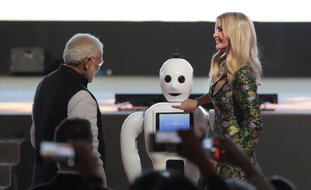 The Associated Press ROBOT BUTTON: Indian Prime Minister Narendra Modi, left watches as U.S. presidential adviser and daughter Ivanka Trump presses the button on a robot during the opening of the Global Entrepreneurship Summit Tuesday in Hyderabad, India.
