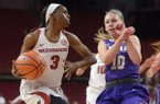 Arkansas guard Malica Monk (3) drives to the lane past Abilene Christian guard Breanna Wright (10) Wednesday, Nov. 29, 2017, during the first half in Bud Walton Arena.