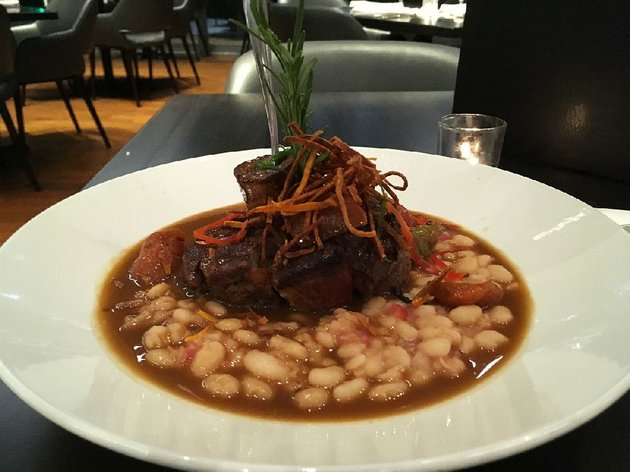 the-thyme-braised-veal-osso-bucco-rises-out-of-a-cannellini-bean-ragu