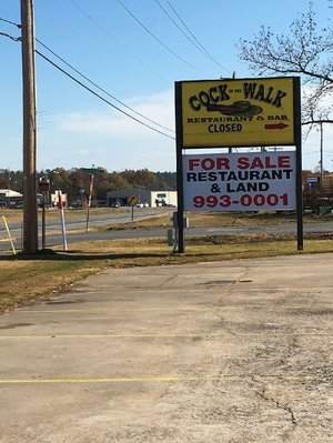 "The sign on Maumelle Boulevard pointing the direction toward Cock of the Walk says ""closed,"" and a large banner proclaims the restaurant and the land is now for sale."