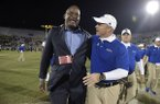 Tulsa head coach Philip Montgomery, right, is congratulated by athletic director Dr. Derrick Gragg after an NCAA college football game against Central Florida on Saturday, Nov. 19, 2016 in Orlando, Fla. Tulsa won 35-20. (AP Photo/Phelan M. Ebenhack)