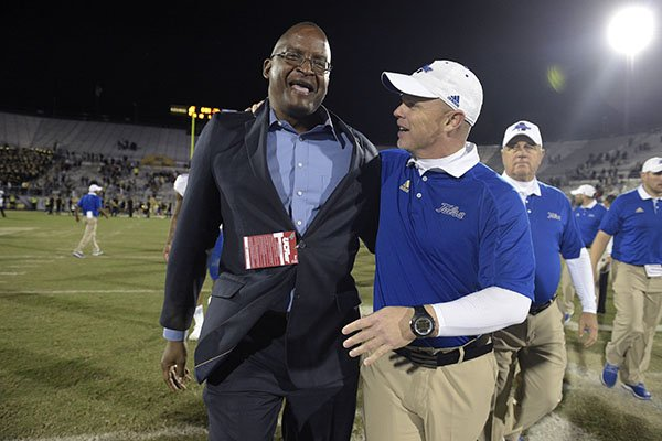tulsa-head-coach-philip-montgomery-right-is-congratulated-by-athletic-director-dr-derrick-gragg-after-an-ncaa-college-football-game-against-central-florida-on-saturday-nov-19-2016-in-orlando-fla-tulsa-won-35-20-ap-photophelan-m-ebenhack