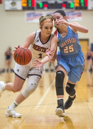NWA Democrat-Gazette/BEN GOFF @NWABENGOFF Erin Graham (25) of Fort Smith Southside strips the ball from Faith Rohrbough (4) of Rogers Heritage on Thursday during the first round of the Great 8 Girls Basketball Classic at War Eagle Arena in Rogers.