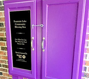 Submitted photo COMMUNITY BLESSING: A community blessing box was recently placed at Fountain Lake Elementary School and stocked with hygiene products and food items to support local families in need.
