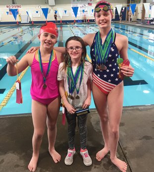 Submitted photo MAKING A SPLASH: Members of the Hot Springs YMCA Seals display their awards from the Paul Blair invitational meet. Aubrey Schmitt, center, won two events and was the high-point award winner for the 8-and-under division while Audrey Simons, left, and Emma Crowe each won an event at the meet.