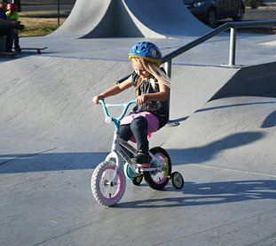 The Sentinel-Record/Mara Kuhn - McKenzie Mull, 4, rides her bike at the Hot Springs Skate Park on Thursday, Nov. 30, 2017, under sunny skies.