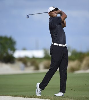 The Associated Press IN FINE FORM: Tiger Woods hits from the fourth fairway at the Hero World Challenge golf tournament at Albany Golf Club in Nassau, Bahamas, Thursday. The tournament is the first that Woods has participated in since withdrawing from the Dubai Desert Classic on Feb. 3 with back spasms.