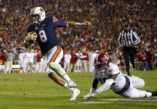 The Associated Press JUST OUT OF REACH: Auburn quarterback Jarrett Stidham (8) gets past Alabama linebacker Dylan Moses (18) to carry the ball in for a touchdown during the second half of the Iron Bowl Saturday in Auburn, Ala.