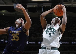 The Associated Press PULLING ONE DOWN: Michigan State's Cassius Winston, right, grabs a rebound against Notre Dame's Bonzie Colson (35) during the first half of an NCAA basketball game Thursday in East Lansing, Mich.