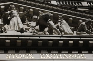 This July 2013 file photo shows the New York Stock Exchange. Asian stock markets were marginally higher Friday after an overnight recovery of technology stocks on Wall Street. An agreement among key crude exporting countries to extend oil production cuts also boosted sentiment. (AP Photo/Mark Lennihan, File)