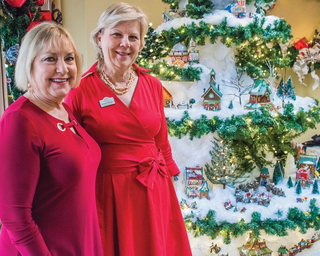 dianne-house-left-and-susan-harper-director-of-volunteers-at-garvan-woodland-gardens-stand-in-front-of-the-christmas-display-featuring-pieces-from-the-department-56-north-pole-village-that-house-donated-to-the-gardens-in-hot-springs-the-holiday-display-can-be-viewed-through-dec-31-in-the-magnolia-room-of-the-pratt-welcome-center