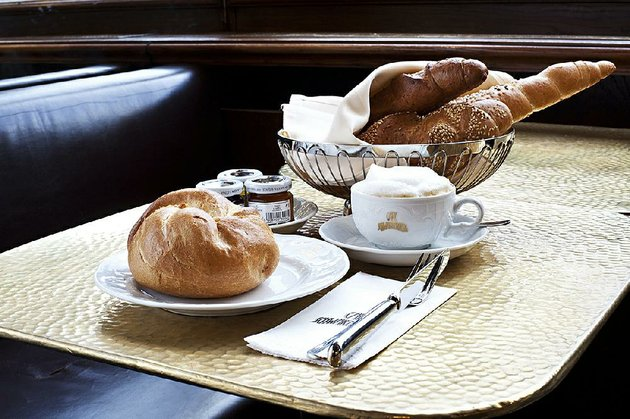 a-traditional-viennese-breakfast-of-coffee-roll-croissant-jam-and-butter-awaits-guests-at-cafe-schwarzenberg-one-of-viennas-oldest-cafes