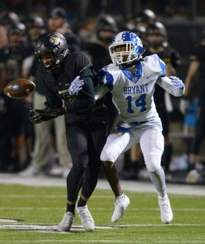 NWA Democrat-Gazette/ANDY SHUPEBentonville cornerback Jadyn Loudermilk (left) nearly picks off a pass intended for Bryant receiver Brandon Murray Friday, Nov. 24, 2017, during the first half of play at Tiger Stadium in Bentonville. Visit nwadg.com/photos to see more photographs from the game.