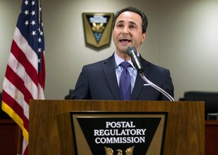 Postal Regulatory Commission Chairman Robert Taub speaks during a news conference in Washington, Friday, Dec. 1, 2017. Federal regulators are moving to give the U.S. Postal Service more freedom to raise stamp costs beyond the rate of inflation. The commission's proposal would allow the beleaguered Postal Service to increase the price of a first-class stamp by an additional 2 percent above the rate of inflation to avoid bankruptcy and improve mail and package delivery. ( AP Photo/Jose Luis Magana)