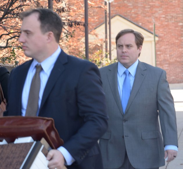 former-state-sen-jon-woods-right-surrounded-by-members-of-his-legal-team-walks-thursday-nov-30-2017-into-the-john-paul-hammerschmidt-federal-building-in-fayetteville