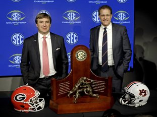 The Associated Press FAMILIAR FOES: Georgia head coach Kirby Smart, left, and Auburn head coach Gus Malzahn pose with the SEC championship trophy during an NCAA football news conference in Atlanta Friday. Auburn handed Georgia its first loss of the season Nov. 11, rolling to a 40-17 victory.