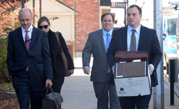 former-state-sen-jon-woods-second-from-right-surrounded-by-members-of-his-legal-team-walks-into-the-john-paul-hammerschmidt-federal-building-in-fayetteville-on-thursday-nov-30-2017