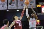 Houston's Corey Davis Jr. (5) takes a shot over the outstretched arms of Arkansas' Dustin Thomas (13) during an NCAA college basketball game, Saturday, Dec. 2, 2017 in Houston. (Wilf Thorne/Houston Chronicle via AP)