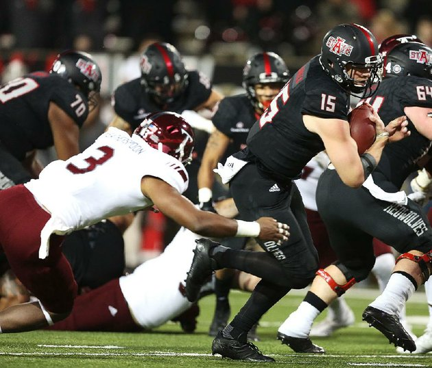 arkansas-state-quarterback-justice-hansen-slips-past-troy-safety-kris-weatherspoon-on-saturday-to-give-the-red-wolves-a-10-7-lead-but-asu-was-outscored-25-15-in-the-second-half-in-a-32-25-loss-to-the-trojans-in-jonesboro