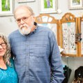 Anita and Edward Hejtmanek, founders of Heartwood Gallery, pause in front of a display of Anita's st...