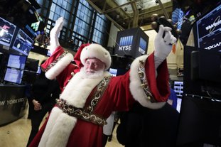 The Associated Press SANTA CLAUS: In this Nov. 25, 2015 file photo, Santa Claus visits the trading floor of the New York Stock Exchange before the opening bell. Stocks have already exceeded most expectations in 2017, and it looks like Santa Claus will drop by to give investors another gift before the year comes to a close.