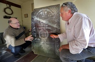 Walter Skold, left, and gravestone carver Michael Updike discuss the design of Skold's future tombstone, Friday, Dec. 1, 2017, in Newbury, Mass. Skold drew inspiration from his visits to the graves of more than 600 poets for his own tombstone to be carved by the son of novelist John Updike. The design represents a poignant and humorous mishmash inspired by the graves of poets including John Keats, Herman Melville, Elizabeth Frost and Frances Osgood. (AP Photo/Robert F. Bukaty)