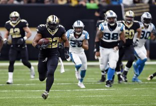 The Associated Press LEADING THE CHASE: New Orleans Saints running back Mark Ingram (22) carries on a 72-yard run in the first half of an NFL game against the Carolina Panthers in New Orleans Sunday. Ingram finished with 85 yards rushing and a touchdown in the Saints' 31-21 win.