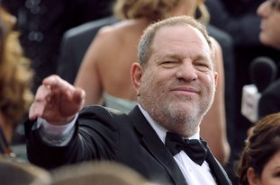 FILE - In this Feb. 22, 2015, file photo, Harvey Weinstein arrives at the Oscars at the Dolby Theatre in Los Angeles. Sexual assault allegations against the media mogul have been keeping police in New York and Los Angeles busy but he isn't the only influential man police are looking at on similar charges. Police in Los Angeles, New York and London are working to untangle an ever-growing mass of allegations of sexual assault and harassment against powerful men. (Photo by Vince Bucci/Invision/AP, File)