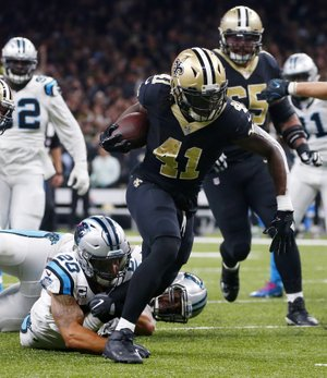 New Orleans Saints running back Alvin Kamara (41) breaks loose from Carolina Panthers free safety Kurt Coleman (20) on a touchdown carry in the second half of an NFL football game in New Orleans, Sunday, Dec. 3, 2017. (AP Photo/Butch Dill)