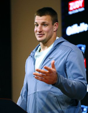 New England Patriots tight end Rob Gronkowski speaks to the media following an NFL football game against the Miami Dolphins, Sunday, Nov. 26, 2017, in Foxborough, Mass.