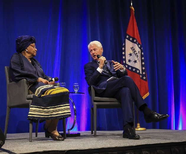 former-president-bill-clinton-right-talks-with-liberian-president-ellen-johnson-sirleaf-on-monday-night-in-little-rock-during-a-conversation-with-president-ellen-johnson-sirleaf-and-president-bill-clinton-part-of-the-frank-and-kula-kumpuris-distinguished-lecture-series