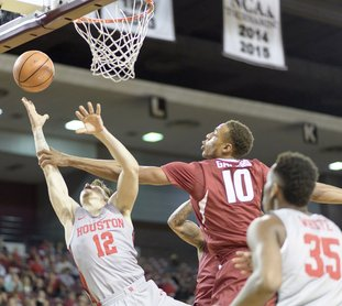 The Associated Press DEFENSIVE FAIL: Arkansas' Daniel Gafford (10) fouls Houston's Wes Vanbeck (12) during the first half of an NCAA basketball game Saturday in Houston. Arkansas head coach Mike Anderson bemoaned his team's lack of defensive effort in Saturday's 91-65 loss in Houston.