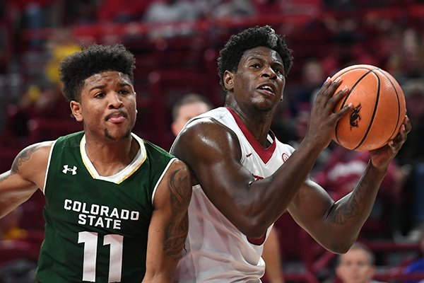 Arkansas guard Jaylen Barford looks to go up for a shot against Colorado State's Prentiss Nixon during a game Tuesday, Dec. 5, 2017, in Fayetteville.