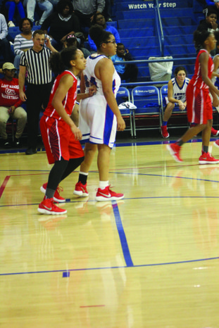 Owning the lane Camden Fairview's Alexis Askew keeps an opposing player out of the lane during a recent game. The Lady Cardinals defeated Magnolia at home last Friday and will play on the road in El Dorado tonight.