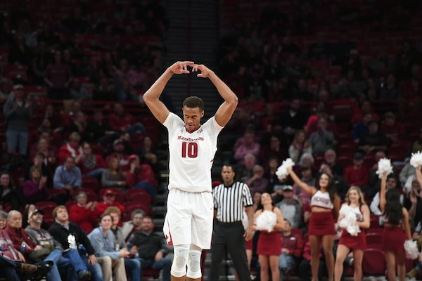 Daniel Gafford motions to the crowd in Arkansas 92-66 win over Colorado State Tuesday Dec. 5, 2017 at Bud Walton Arena in Fayetteville.