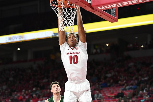 Arkansas center Daniel Gafford dunks the ball during a game against Colorado State on Tuesday, Dec. 5, 2017, in Fayetteville.