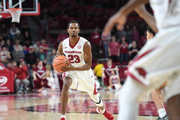 Arkansas guard C.J. Jones looks to pass during a game against Colorado State on Tuesday, Dec. 5, 2017, in Fayetteville.