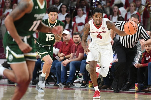 Arkansas guard Daryl Macon brings the ball up the floor during a game against Colorado State on Tuesday, Dec. 5, 2017, in Fayetteville.