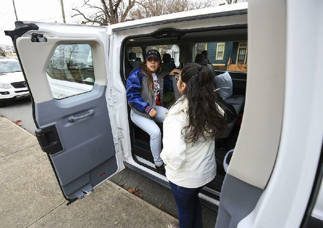 michel-rangel-right-and-maria-meneses-wait-in-a-van-tuesday-morning-in-little-rock-for-a-trip-to-washington-dc-to-attend-a-rally-today-in-support-of-deferred-action-for-childhood-arrivals