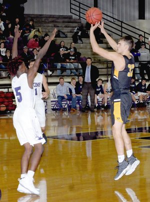 MARK HUMPHREY ENTERPRISE-LEADER/Prairie Grove junior Will Pridmore launches a 3-point shot against Elkins' Chad Graham. Pridmore made three shots from 3-point land and scored 11 points, but Elkins beat the Tigers, 45-38, Friday.