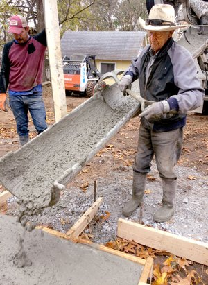 Westside Eagle Observer/JANELLE JESSEN Lindy Chamberlain, 87, of Gentry, pours concrete at a job in Siloam Springs.