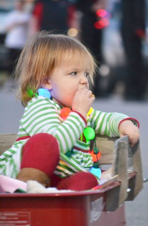TIMES photograph by Annette Beard From the youngest to the eldest, Pea Ridge residents turned out for the annual Christmas parade Saturday. The holiday festivities culminated with the turning on of the lights downtown and visits with Santa in the School Heritage building.