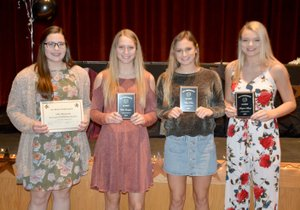 Graham Thomas/Herald-Leader Four Siloam Springs volleyball players were recognized with 6A-West Conference awards. Senior Allie Bowman, left, was named all-conference honorable mention, while juniors Ellie Lampton, Chloe Price and senior Shaylon Sharp were all-conference. The award ceremony was held Sunday at the Siloam Springs High School theater.