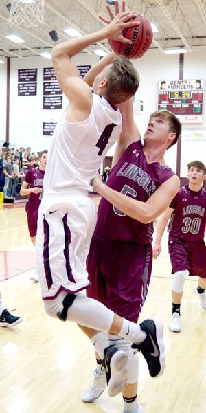 RANDY MOLL NWA MEDIA Lincoln's Caleb Hale challenges a shot by Gentry's Jon Faulkenberry during play between Gentry and Lincoln at Gentry High School on Friday, Dec. 1, 2017. Lincoln won 56-54.
