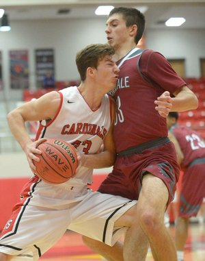 NWA Democrat-Gazette/ANDY SHUPE Farmington's Jacob Gray (left) and Springdale's Carl Fitch collide Tuesday during the first half in Cardinal Arena in Farmington. Visit nwadg.com/photos to see more photographs from the game.