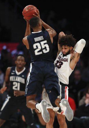 The Associated Press STAND-OUT JUNIOR: Villanova guard Mikal Bridges (25) puts up a shot against Gonzaga guard Zach Norvell Jr. (23) during the first half of an NCAA basketball game Tuesday in New York.