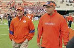 Offensive coordinators Chad Morris of Clemson, left, and Gus Malzahn of Auburn, right, walk prior to a game Saturday, Sept. 17, 2011, in Clemson, S.C. (AP Photo/Anderson Independent-Mail, Mark Crammer)