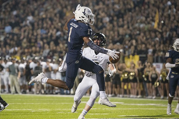 Bentonville West receiver Jadon Jackson (1) scores a touchdown during the second quarter of a game against Bentonville on Friday, Nov. 3, 2017, in Bentonville.