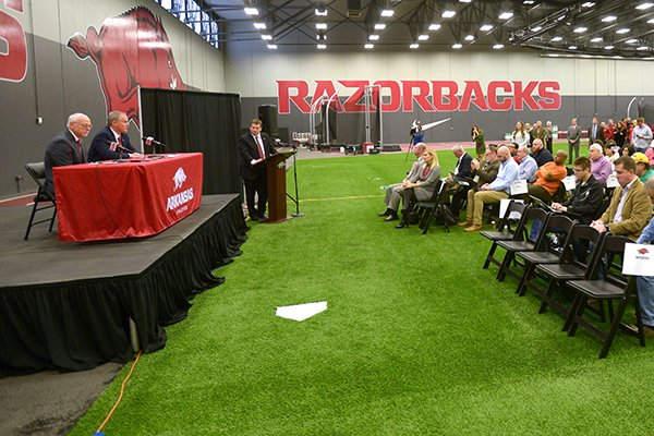 Arkansas chancellor Joe Steinmetz and athletics director Hunter Yurachek answer questions during a news conference Wednesday, Dec. 6, 2017, in Fayetteville.